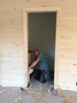 our fabulous builder nailing up trim